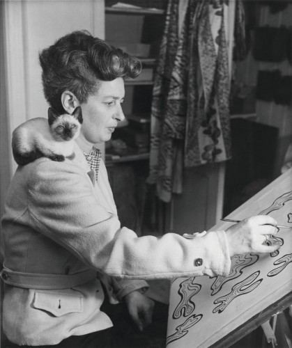 Enid Marx working on a textile design post, 1945